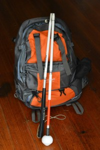 Cane, backpack and able