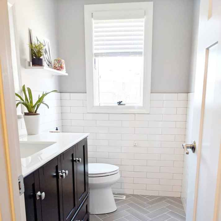 white and grey bathroom with white blinds in window