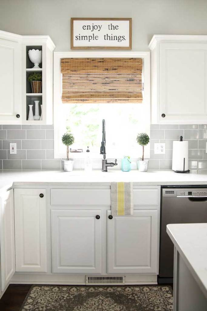 white kitchen sink window woven wood shades farmhouse