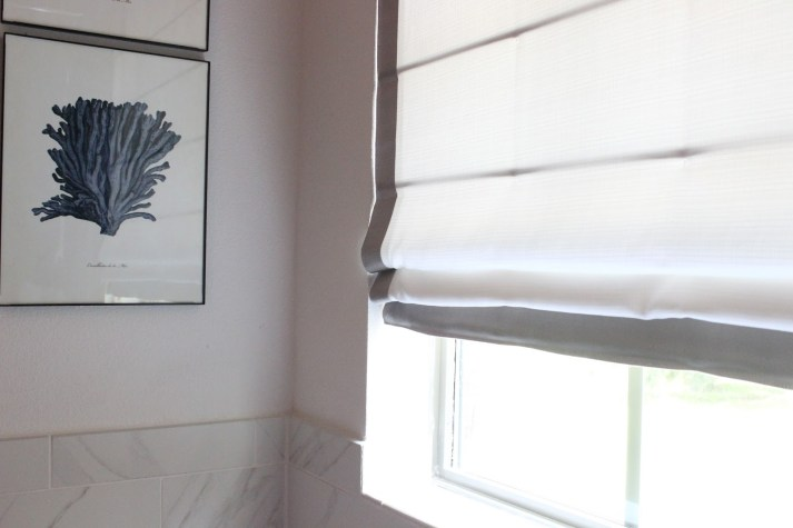 Close-up of the master bathroom Blinds.com roman shades
