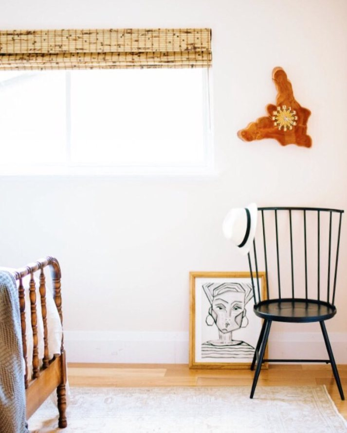 Second bedroom window with bamboo shade on window, retro burl wood clock and black windsor chair