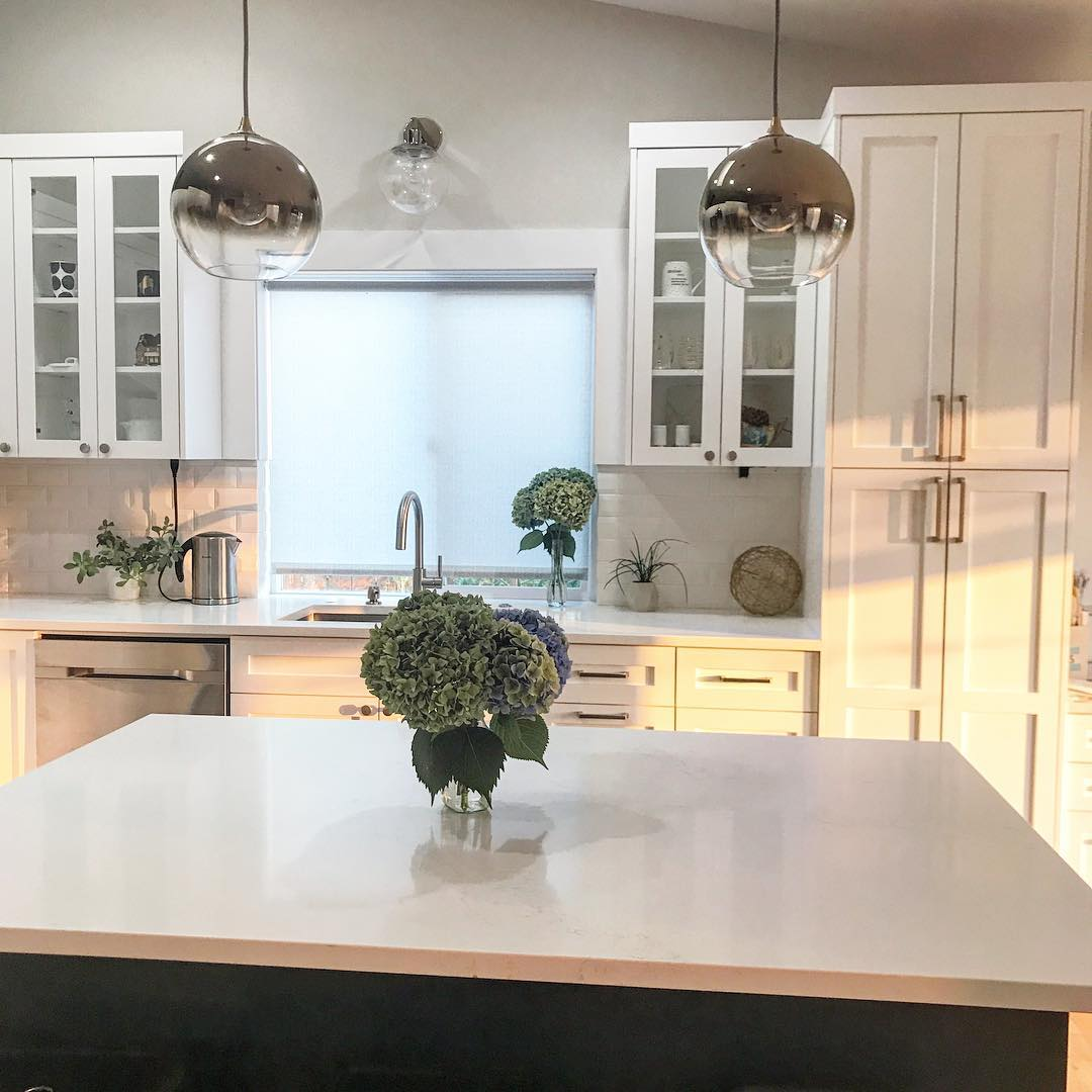 kitchen shades solid surface sinks 5 fresh ideas for window treatments the finishing touch white with metallic globe pendant lights large island and flat roller shade behind