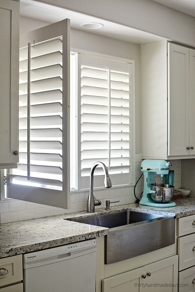 grey kitchen blinds butcher block 5 fresh ideas for window treatments the finishing touch shutters on over sink with one panel open