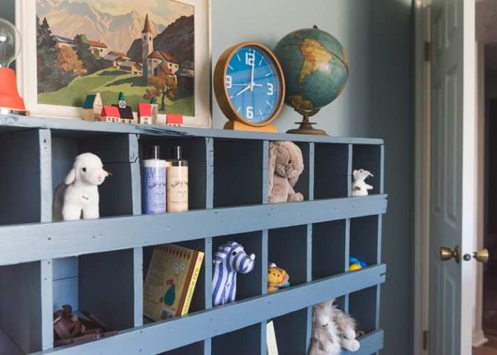 Kids room storage with large wood furniture piece with cubbies to hold stuffed animals, baby shampoo and books