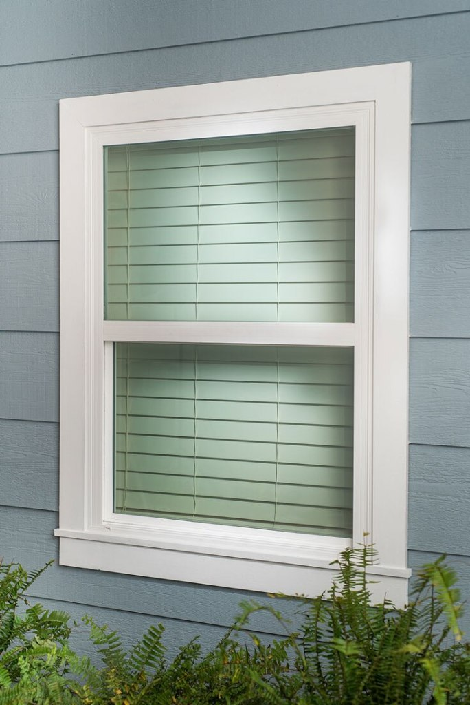 two inch white wood blinds from outside of home