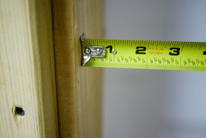 tape measure being used to find size of window