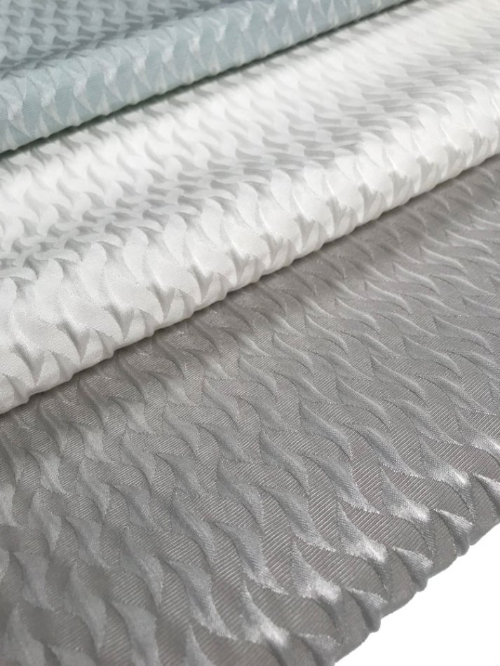 textured roman shade fabric in light blue, white and grey