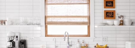 kitchen window with light filtering woven wood shades from Blinds.com