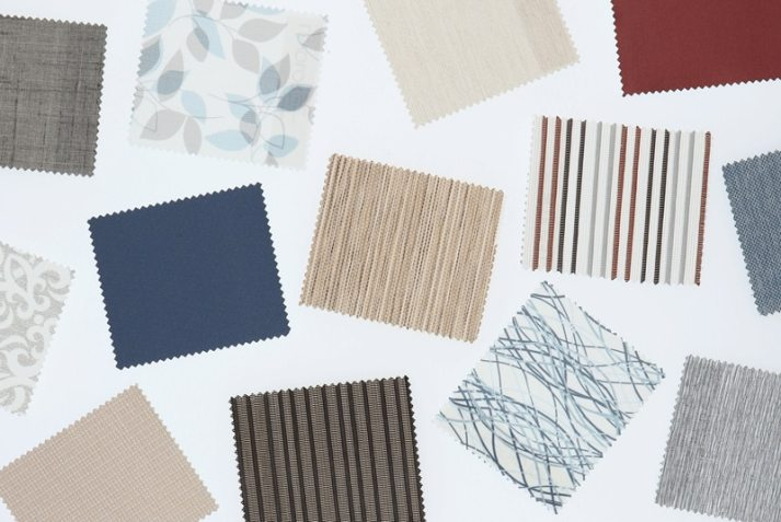levolor roller shade fabric swatches scattered on table