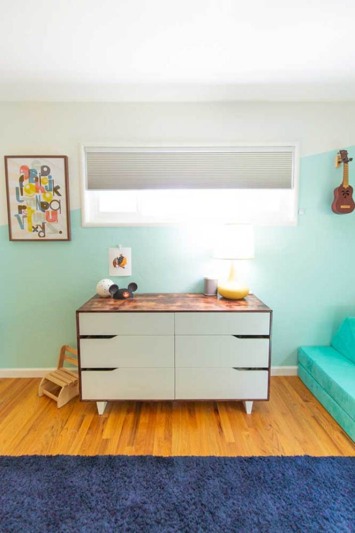 mid century colorful kids bedroom with neutral cellular shades in window
