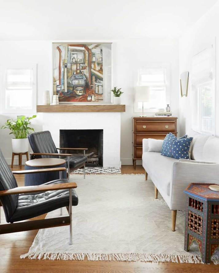 White living room with modern eclectic furniture and whiter roman shades on windows