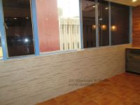 Brick Style Wallpaper with Laminated Wood Flooring To