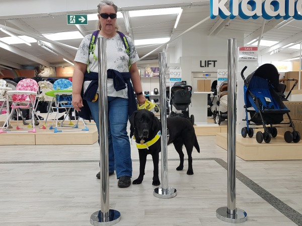 Sense and Sensibility: Tracey and Guide Dog Oakley negotiating barriers whilst shopping.