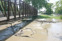 It took MDOT crews several hours Sunday working into the night to break the logjam in the River Raisin. Copyright 2015, River Raisin Publications, Inc.