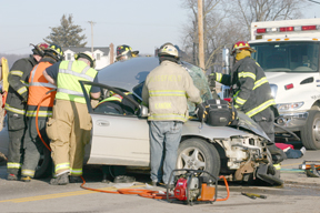 Rescuers work to extricate the victim from Monday's crash at the corner of U.S. 223 and Silberhorn Highway. Copyright 2015, River Raisin Publications, Inc.