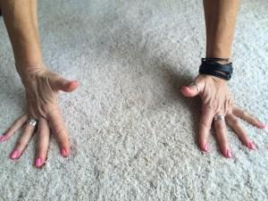 Side to side rolling across knuckles.