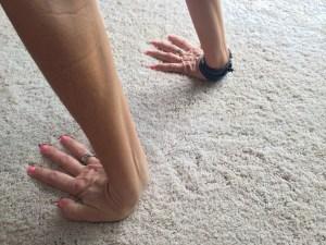 Turn fingers towards knees.