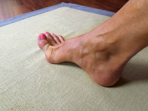 Lift your arches by lifting your toes.