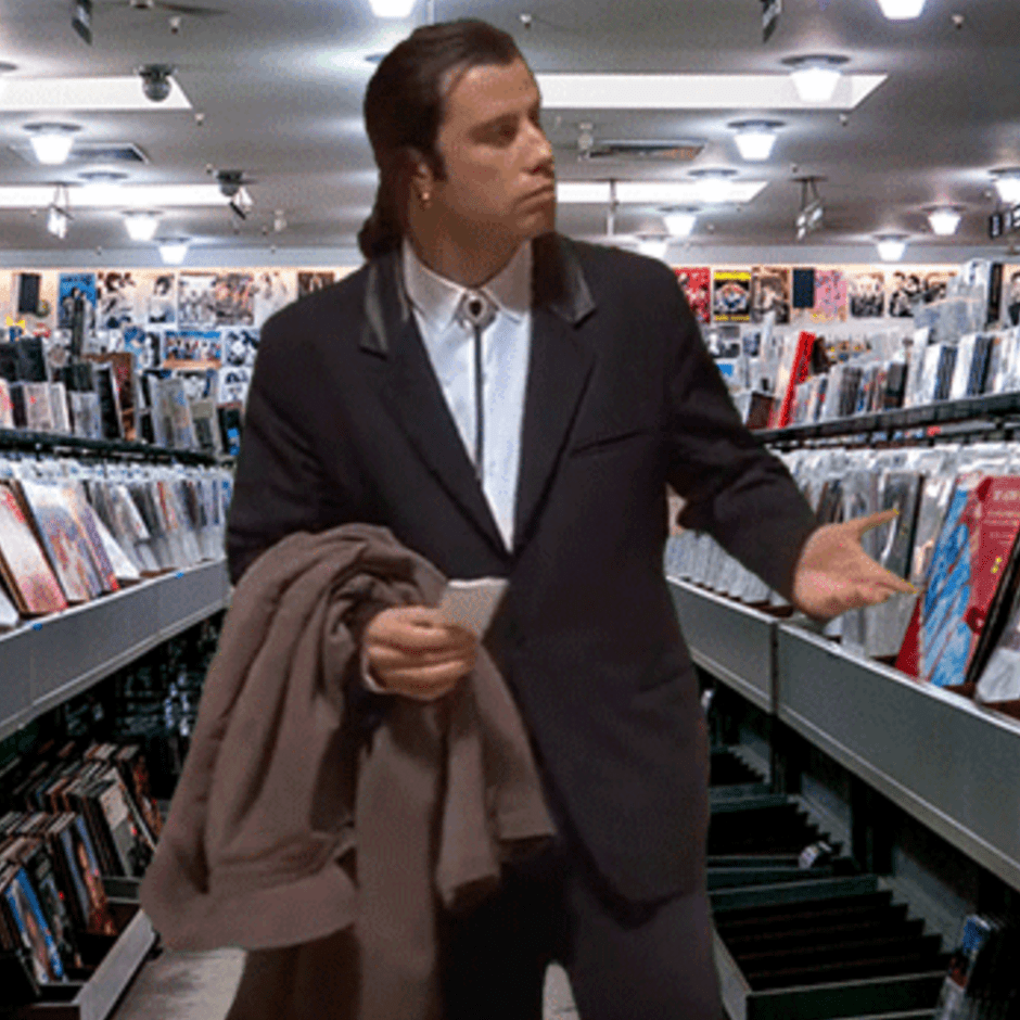 Confused John Travolta in a record store