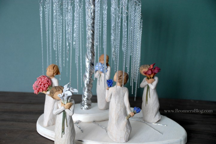 Icicle ornaments create light-reflective weeping willows to a DIY wire tree in this Willow tree figurine display.
