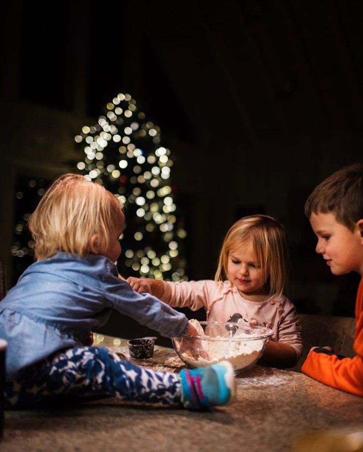 Children enjoy Christmas time baking.