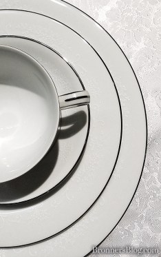 Heirloom china set place setting on lace tablecloth