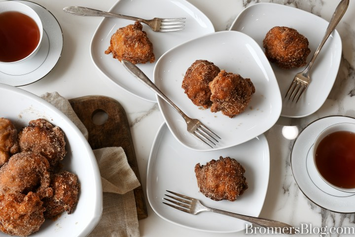 Plated apple fritters made from our apple fritters recipe paired with tea