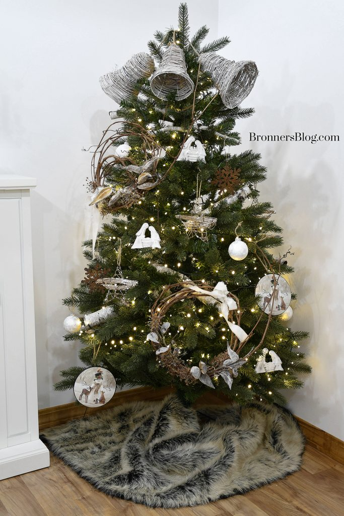 The  tree is full of natural decor for Christmas from top to bottom and is lit with warm white LED lights.