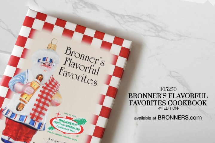 Bronner's Flavorful Favorites Cookbook, First Edition on marble table top includes our apple fritters recipe