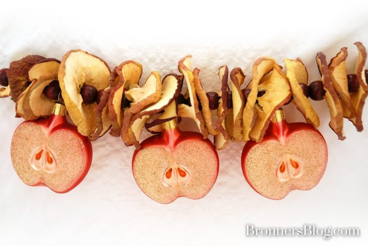 Garland of dried apple slices, brown wooden beads and half-apple glass ornaments