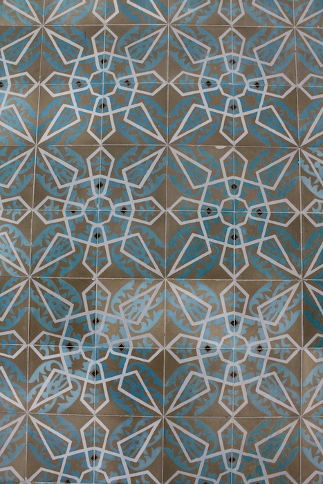 cement tiles in turquoise, brown and white on floor in Mexico