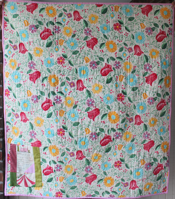 Floral backing and label of modern circus baby quilt by Doris Lovadina-Lee