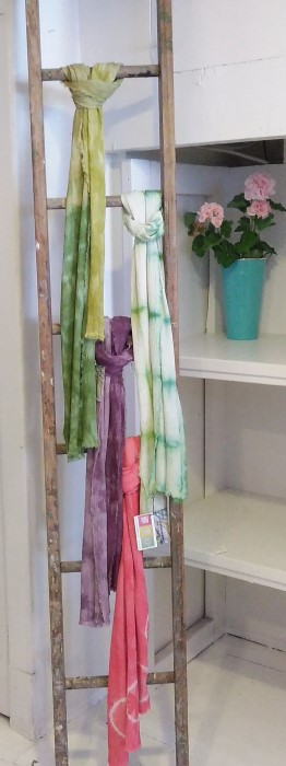 Hand dyed shibori scarves displayed on ladder in Field and Flower shop Danforth Ave. Toronto