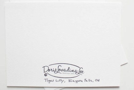 back of blank card with Doris Lovadina-Lee logo, name of flower Tiger Lily and location photograph taken Niagara Falls, Ontario