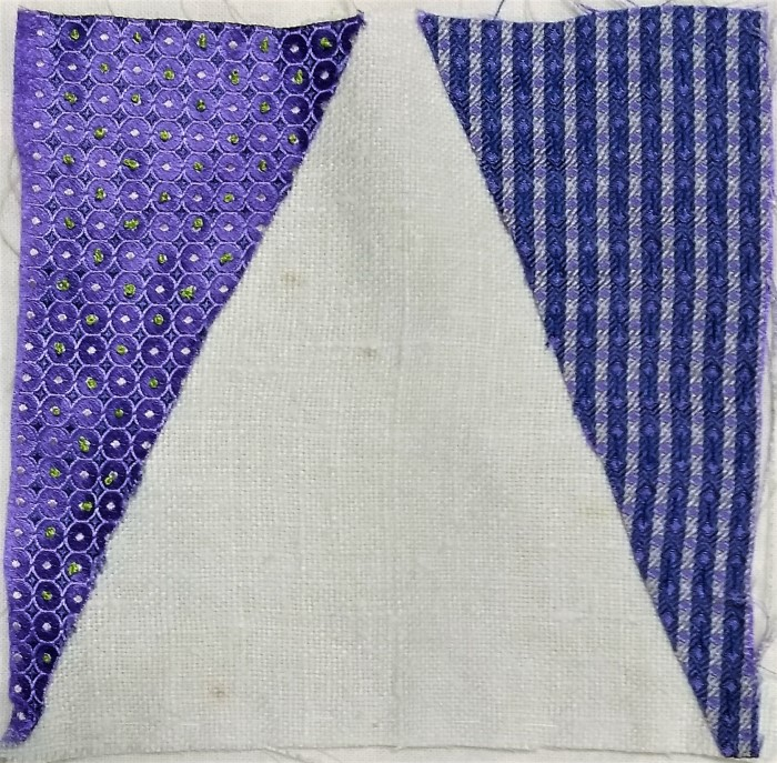 Doris' stitch meditation day 6 white linen, purple and blue silk cotton and rayon thread
