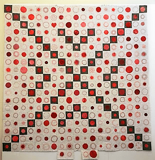 quilted circles in red on grey and white background made up of 365 squares