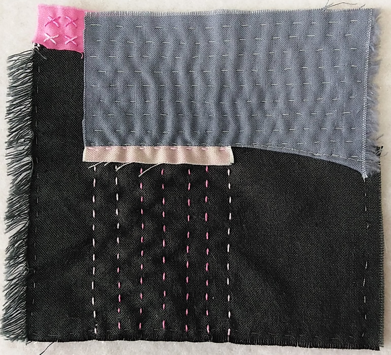 Stitch meditation for day 7, a five inch square with charcol gray, small pink square, rectangular light grey piece stitched to sliver of pink cotton