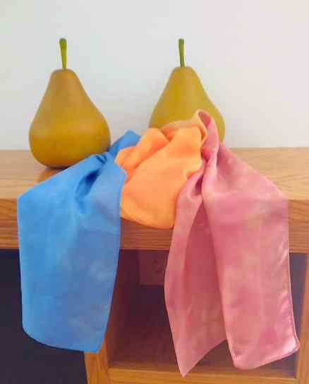blue orange and red silk scarf draped on a mantel with 2 pears photographed by doris lovadina-lee canadian artist
