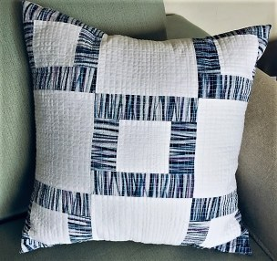 white and blue pillow with shibori strips by @dyeforfun