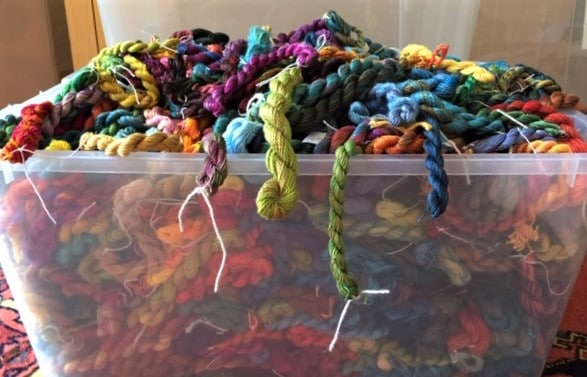 plastic tub filled with hand dyed threads by Anne Peters