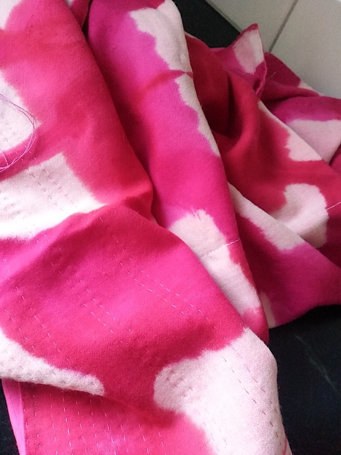 folded scarf with running kantha stitches in pink thread by doris lee canadian textile dyer