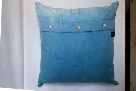 back of indigo dyed pillow with 3 button closure