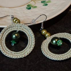 green crochet circle earrings with green dangly beads