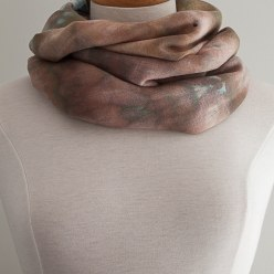 wrapped around neck of a dressmaker's judy wool scarf snow dyed in canada by toronto artist doris lovadina-lee
