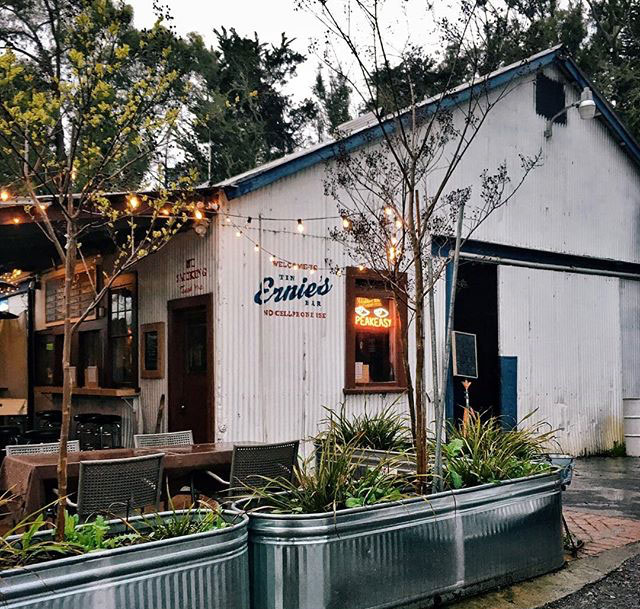 Ernie's Tin Bar in Petaluma, hand lettered sign, galvanized tin planters, inviting patio space with string lights | Gather Goods Co