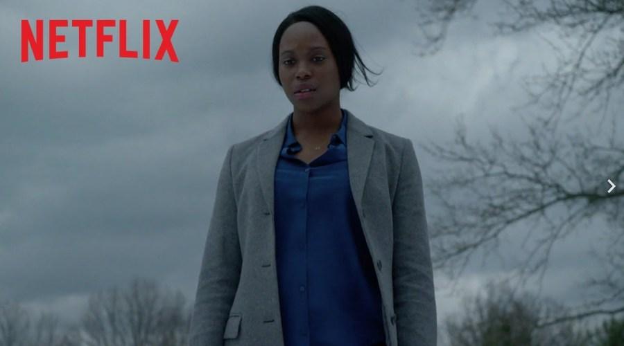 Clare-Hipe Ashitey como KJ, fiscal beoda, fanática del karaoke, en busca de redención