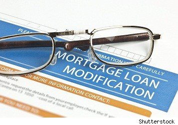 mortgage loan modification application with reading glasses