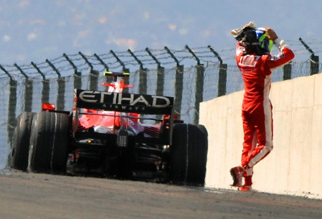 Disconsolate Massa walks away from his Ferrari (Source: autoblog.com)