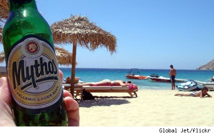 A bottle of Mythos on the beach