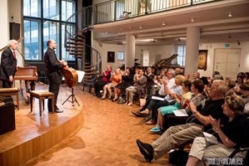 Bruno Canino e Vittorio Ceccanti mentre ricevono gli applausi del pubblico di ItalienMusiziert